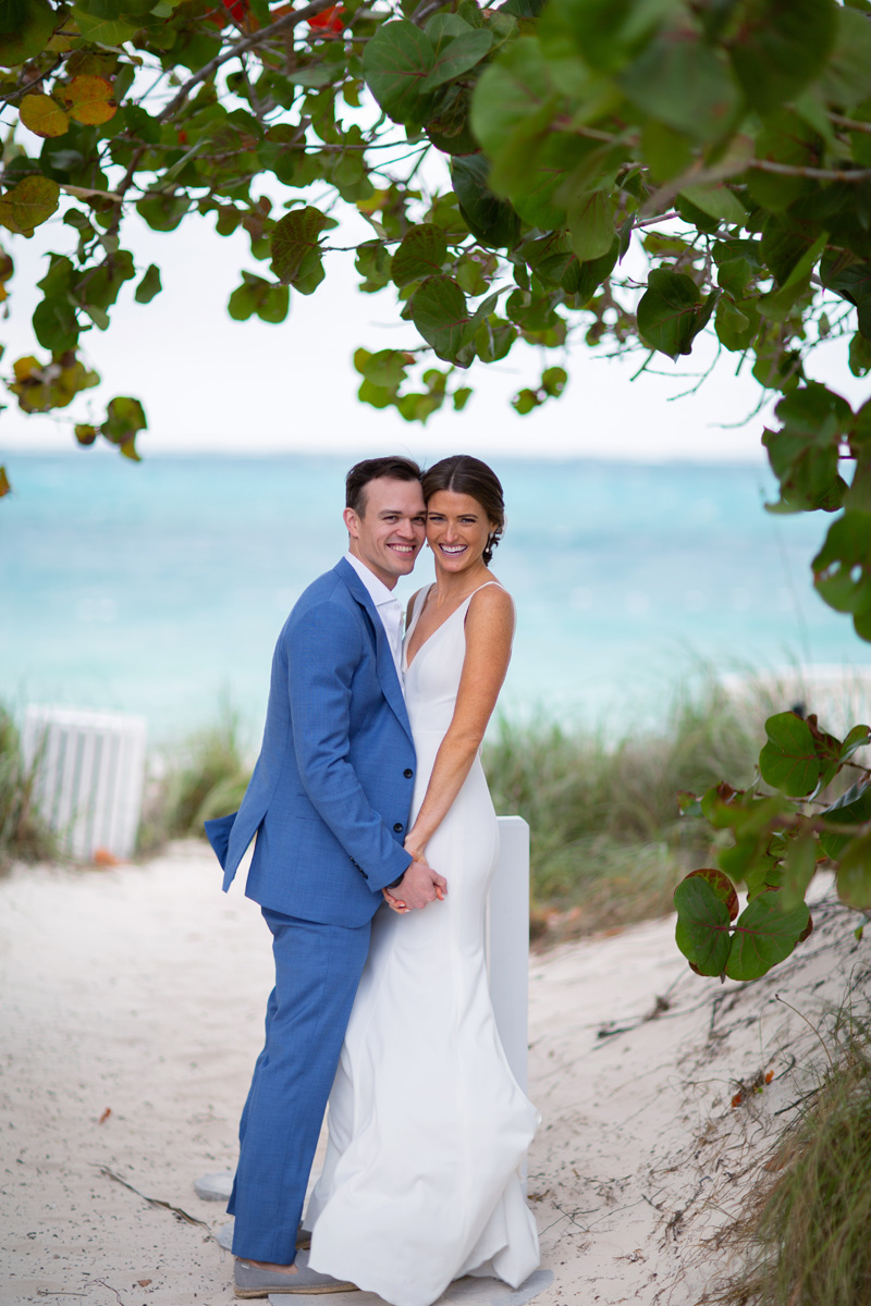 bride and groom on beach at Lyford Cay Club