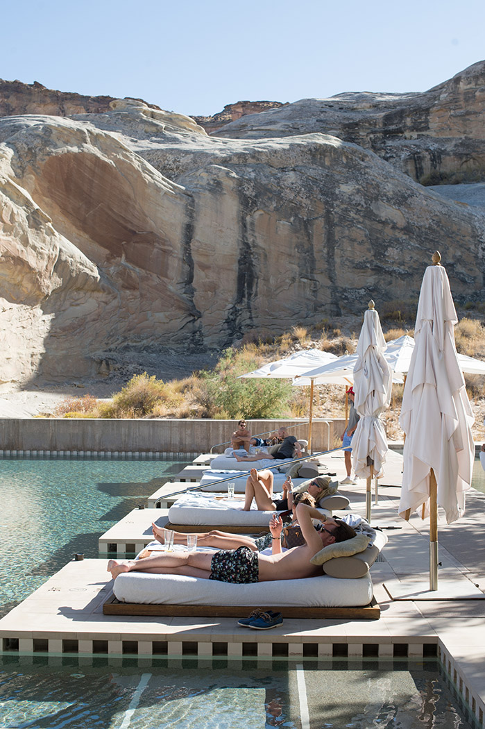 guests enjoying poolside at amangiri