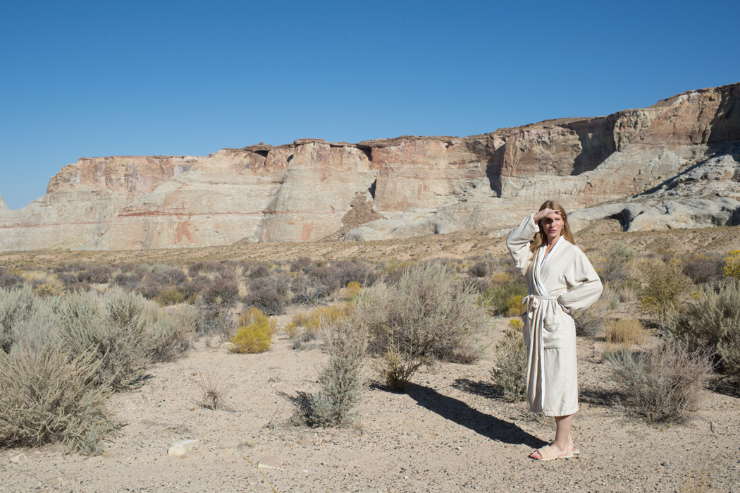 woman in robe standing in the Utah desert at Amangiri