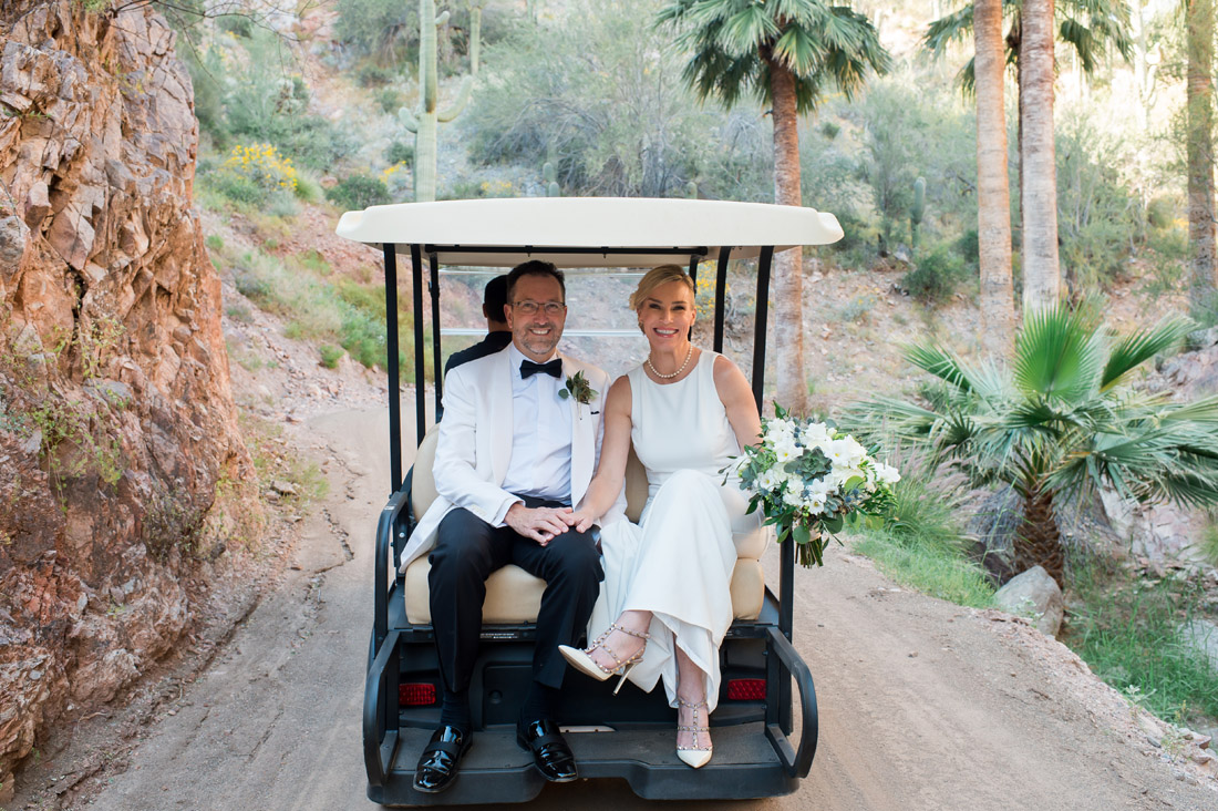 castle hot springs wedding couple in a golf cart