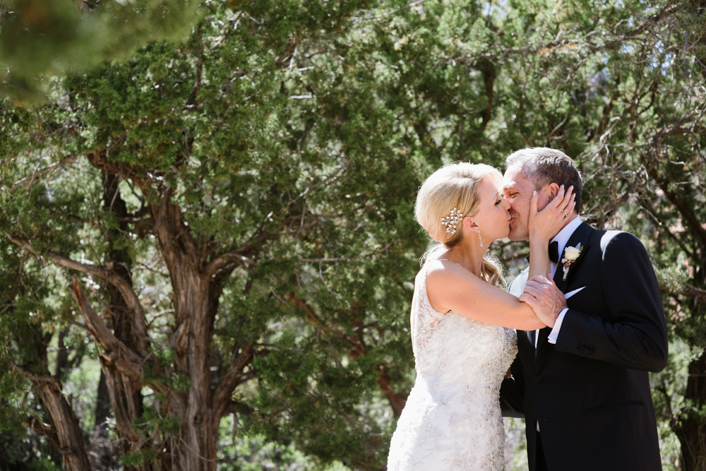 Spring Enchantment Resort Wedding Bride and Groom Kissing