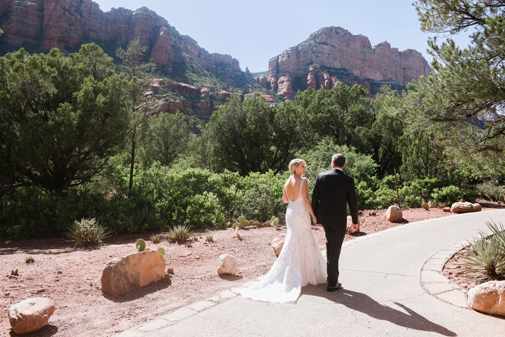 Enchantment Resort Wedding Bride and Groom walking the pathways
