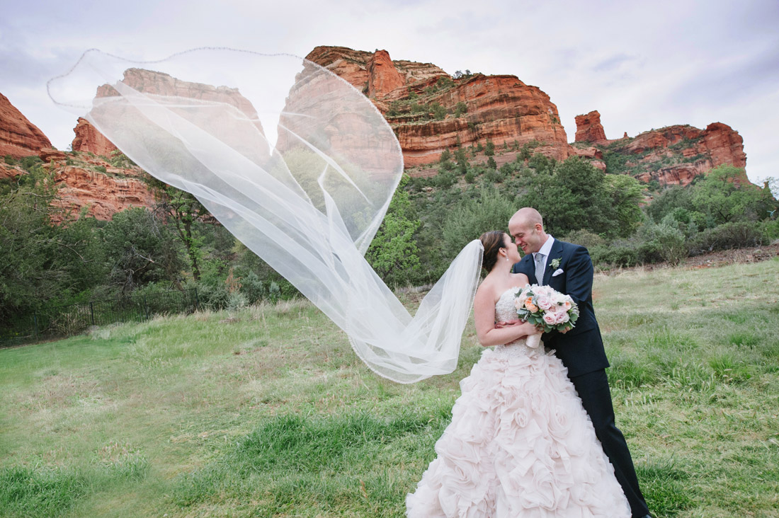 Enchantment Resort portrait of a bride and groom with sedona red rocks