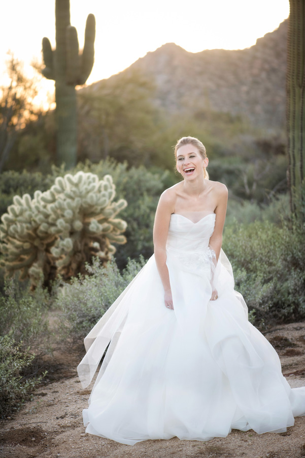 four seasons scottsdale bride laughing with saguaro cactus