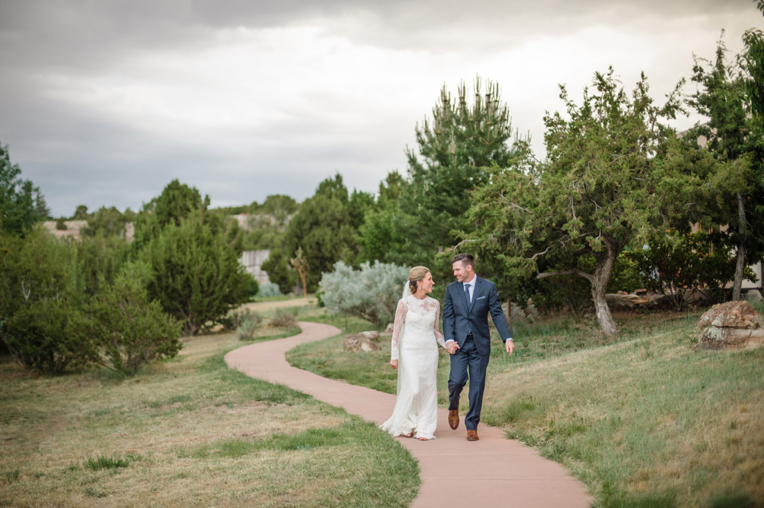 Four Seasons Santa Fe Wedding Couple Walking pathways