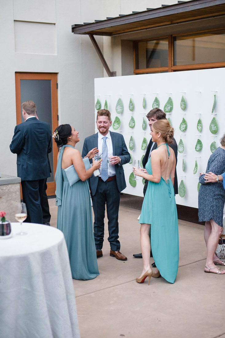 Four Seasons Santa Fe Wedding guests enjoy cocktail hour on the patio