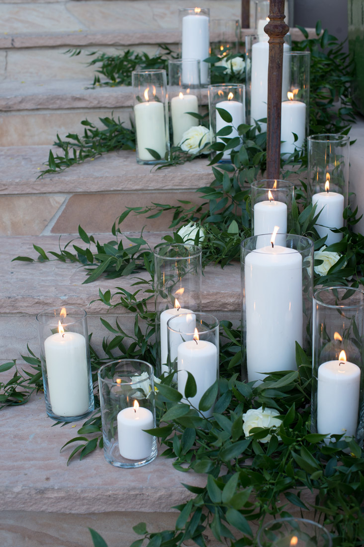 pillar candles and greenery on stairs
