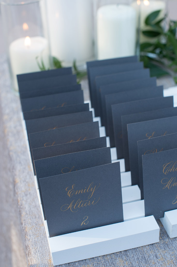 gray escort cards with gold calligraphy