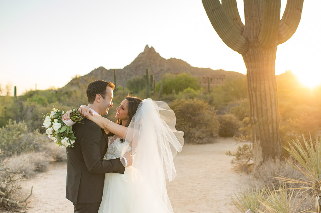 Giant Saguaro cactus at the Four Seasons with bride and groom