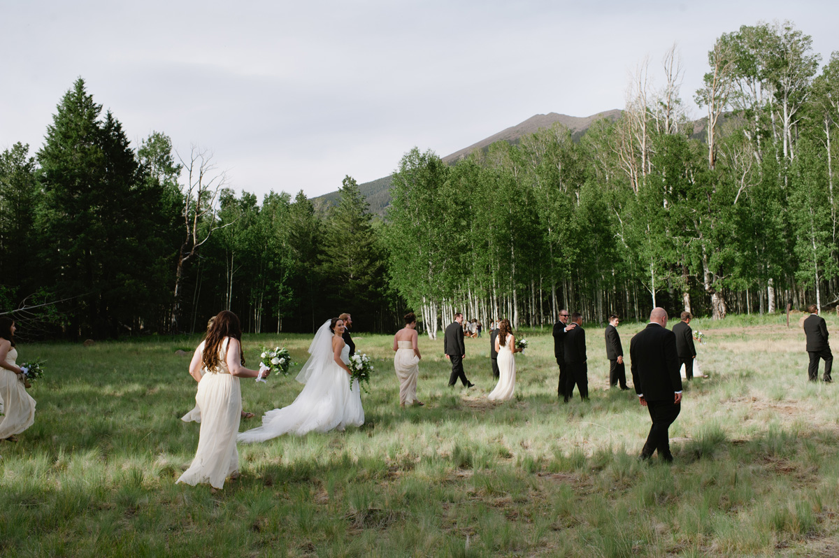 black tie bridal party walking at Aspen Corner in Flagstaff