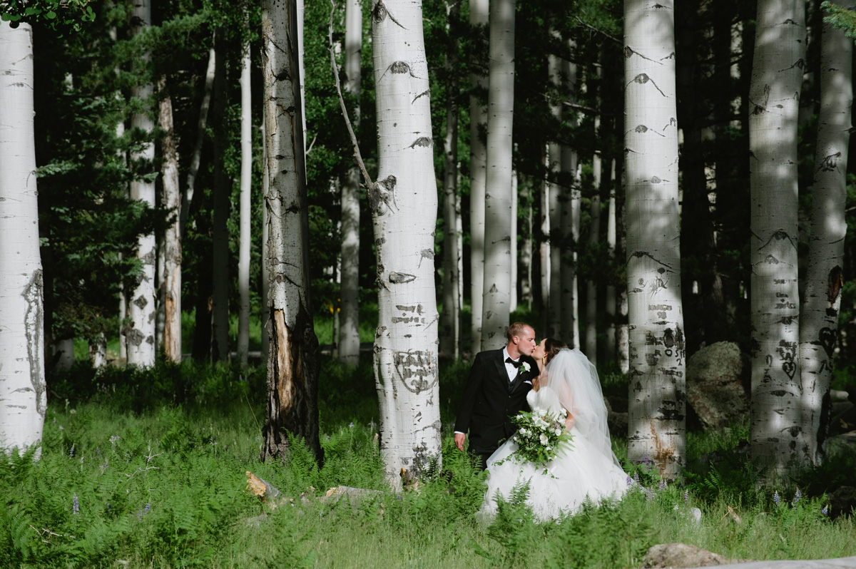 bride and groom kissing in an Aspen grove in Flagstaff