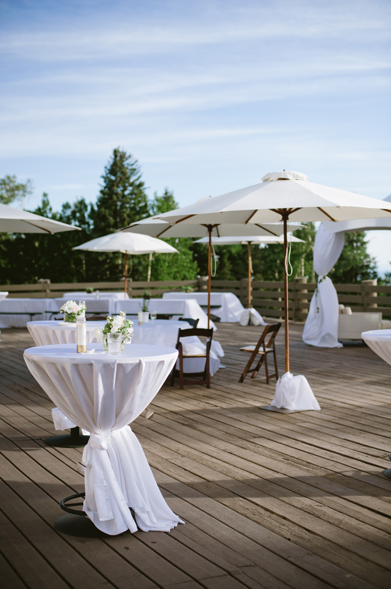 Arizona Snowbowl deck with wedding cocktail tables and umbrellas