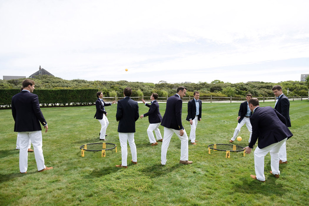 Ralph Lauren White Chinos with Groomsmen playing spike ball before a Nantucket Wedding