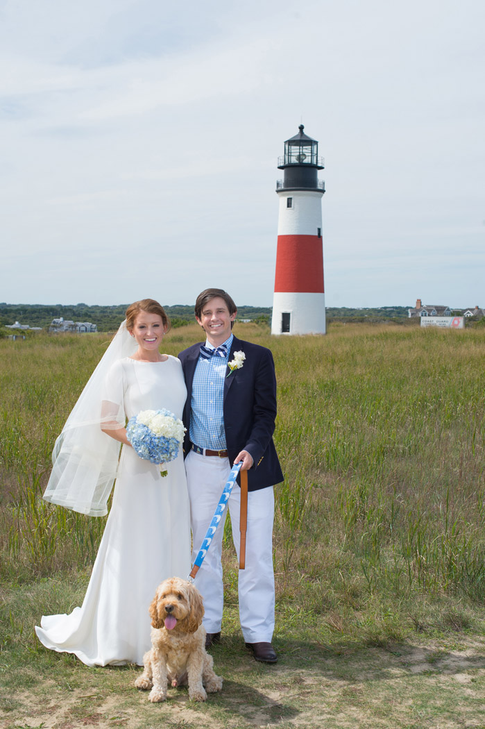 bride and groom in front of the Sconset Lighthouse in Nantucket