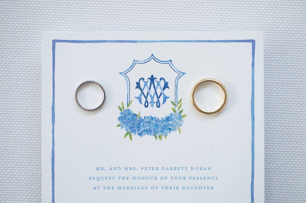 wedding bands on the watercolor monogram crest by Kelsey