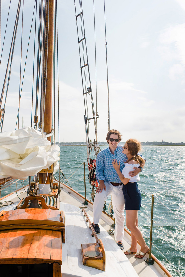 engagement photos on a sailboat in Nantucket with the blue sea