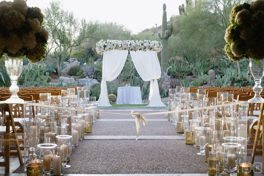Cactus wedding backdrop gold candles chuppah