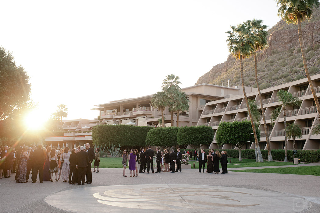 guests and a sunset wedding ceremony at phoenician resort