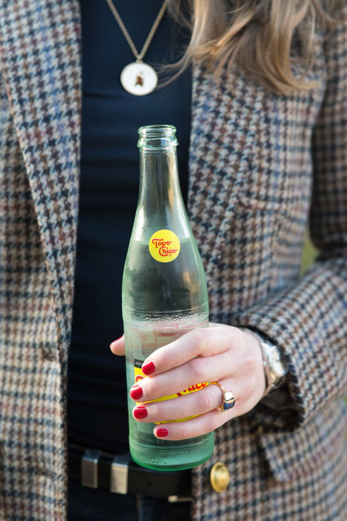 topo chico and red nails with a sapphire engagement ring