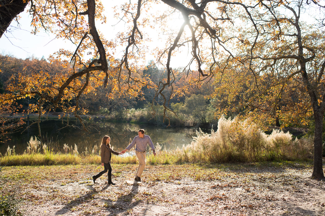 fall engagement session by a pond