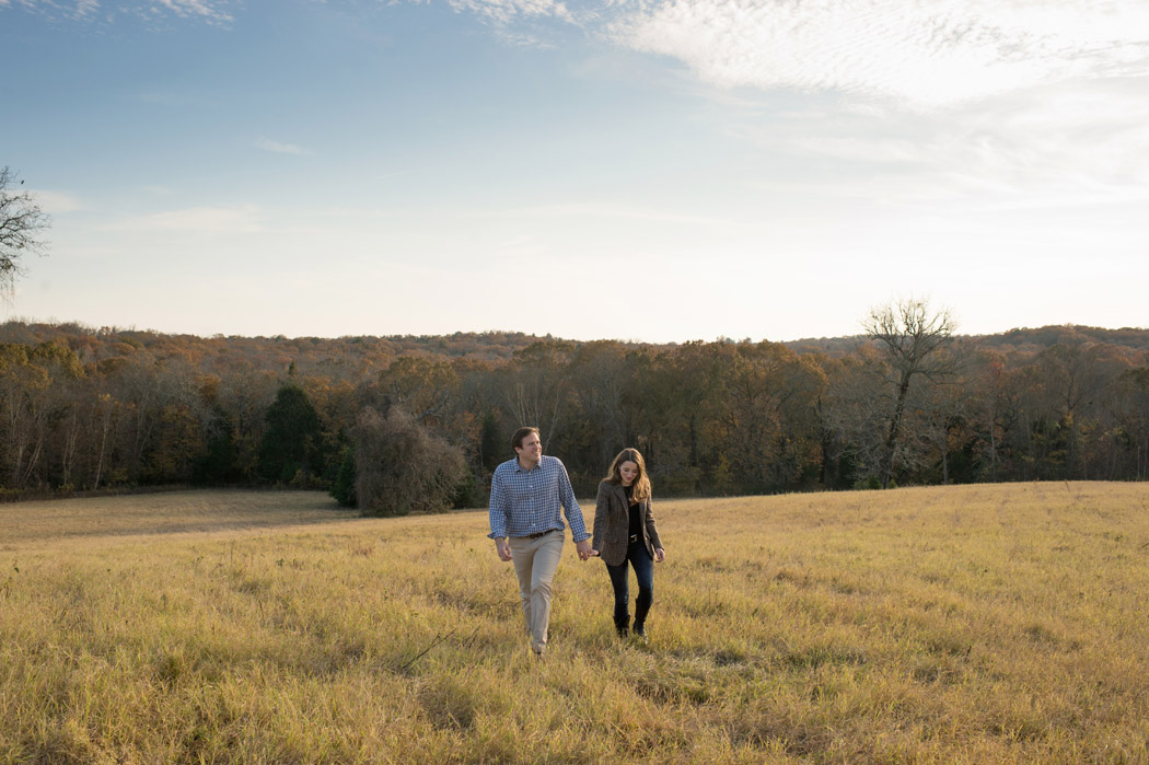 couple walking in a field at a texas ranch