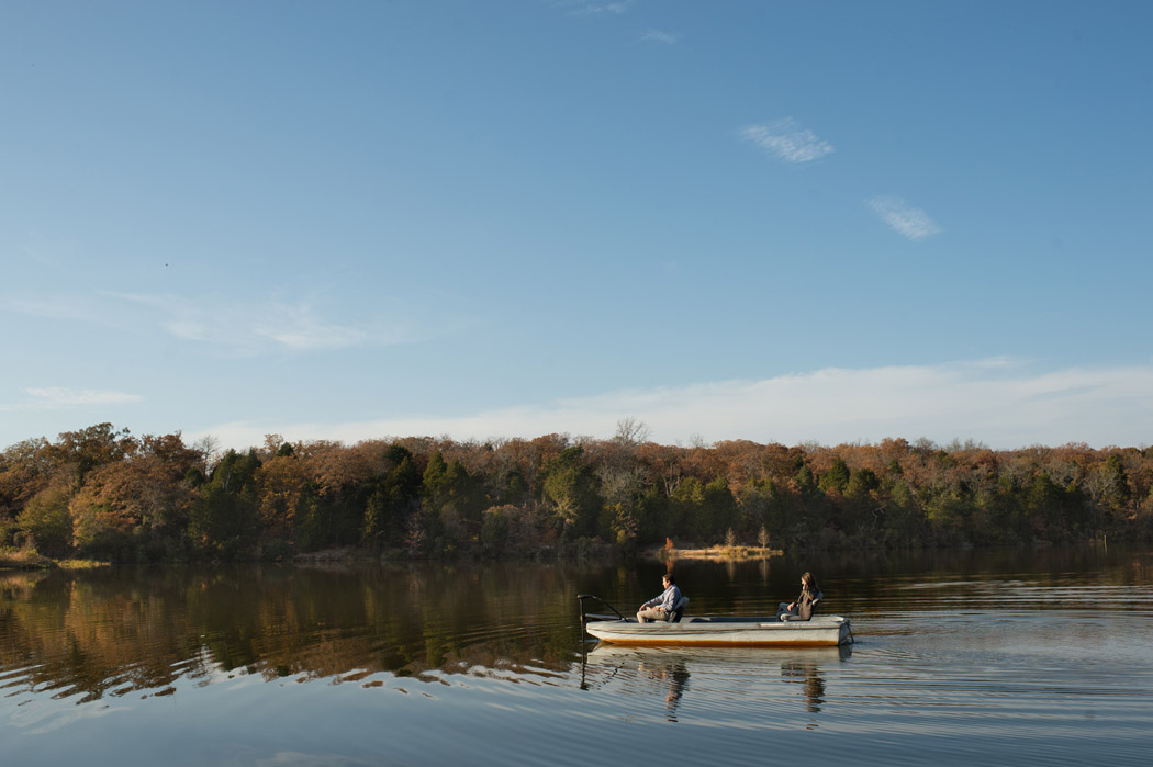 couple in a fishing boat on a lake in texas